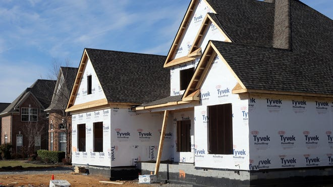 A house is under construction at Salem Cove Lane Thursday. New home construction still lags 2006 levels, but home values in Rutherford County have surpassed those seen at the height of the bubble,year-end data indicate.