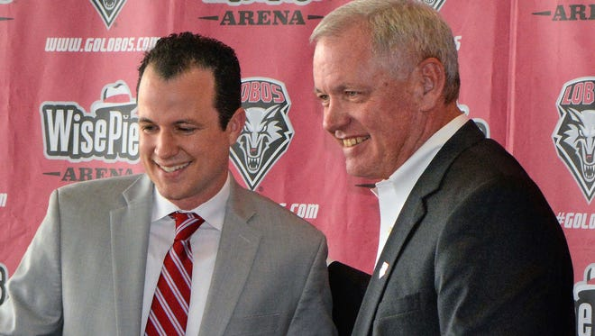 New Mexico's new mens' basketball coach, Paul Weir, left is welcomed to UNM by athletic director Paul Krebs in Albuquerque, N.M., Tuesday April 11, 2017.