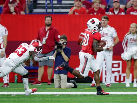Ball State running back Walter Fletcher (20) runs past Indiana defensive back Jaylin Williams (23) on his way to a touchdown during the second half of an NCAA college football game in Indianapolis, Saturday, Aug. 31, 2019. Indiana defeated Ball State 34-24. (AP Photo/Michael Conroy)