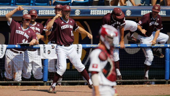 Texas A&M Corbin Martin, center, celebrates with his teammates outside of the dugout on Thursday after Texas A&M scored against South Carolina in the second inning at the Southeastern Conference baseball tournament in Hoover, Ala.