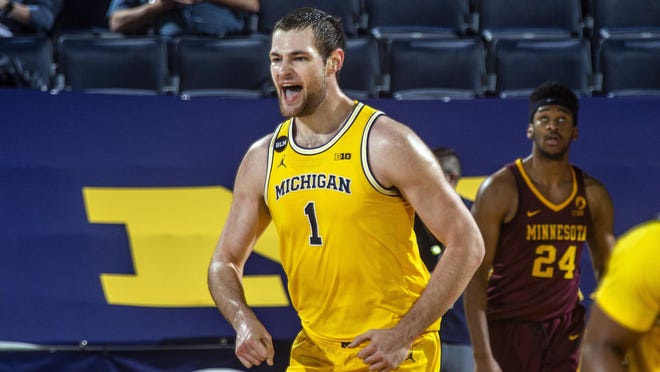 Michigan guard Franz Wagner (21) celebrates after making a dunk in the first half of an NCAA college basketball game against Minnesota at Crisler Center in Ann Arbor, Mich., Wednesday, Jan. 6, 2021.
