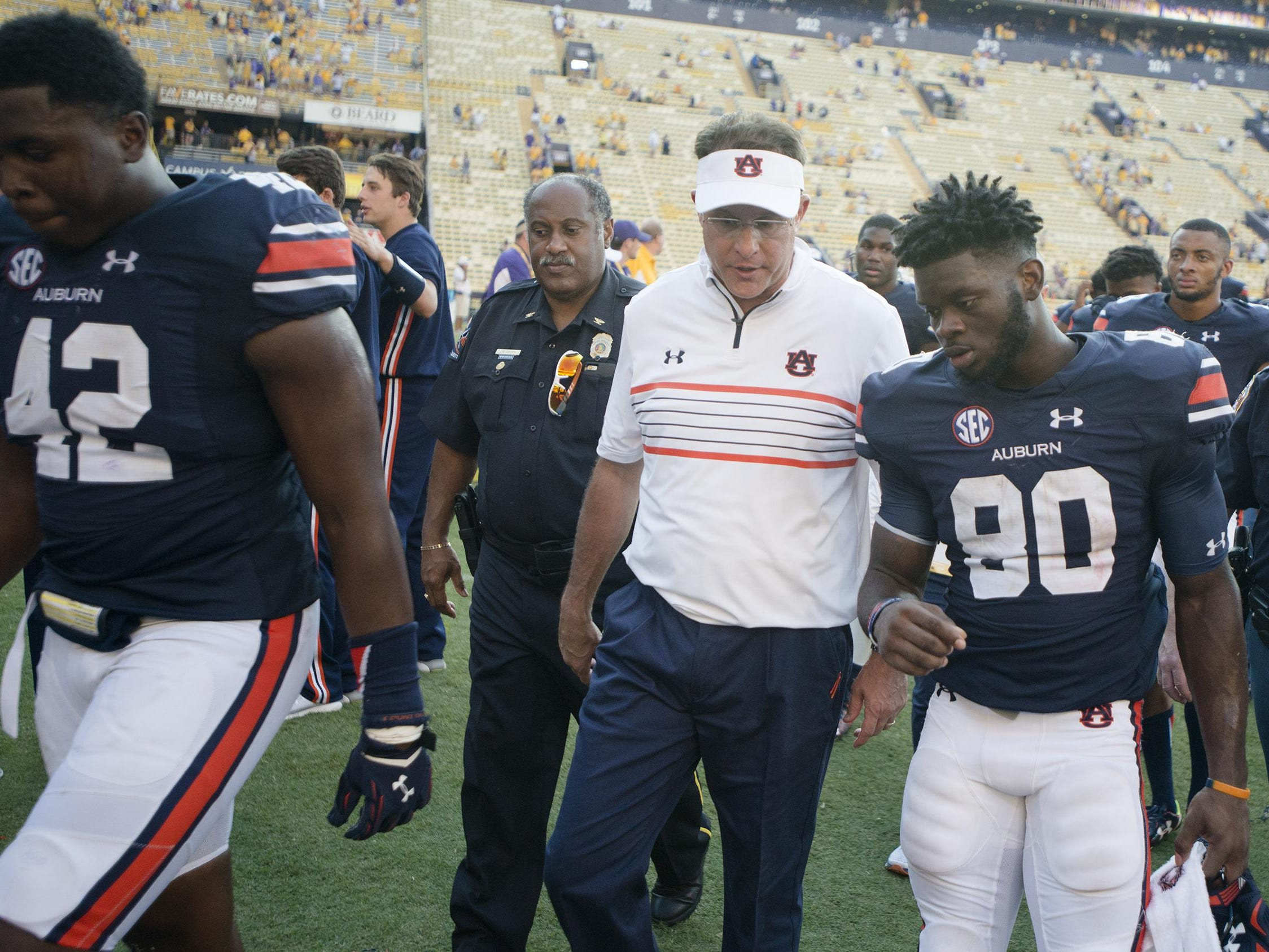 Auburn head coach Gus Malzahn talks to wide receiver Marcus Davis after their 45-21 loss.