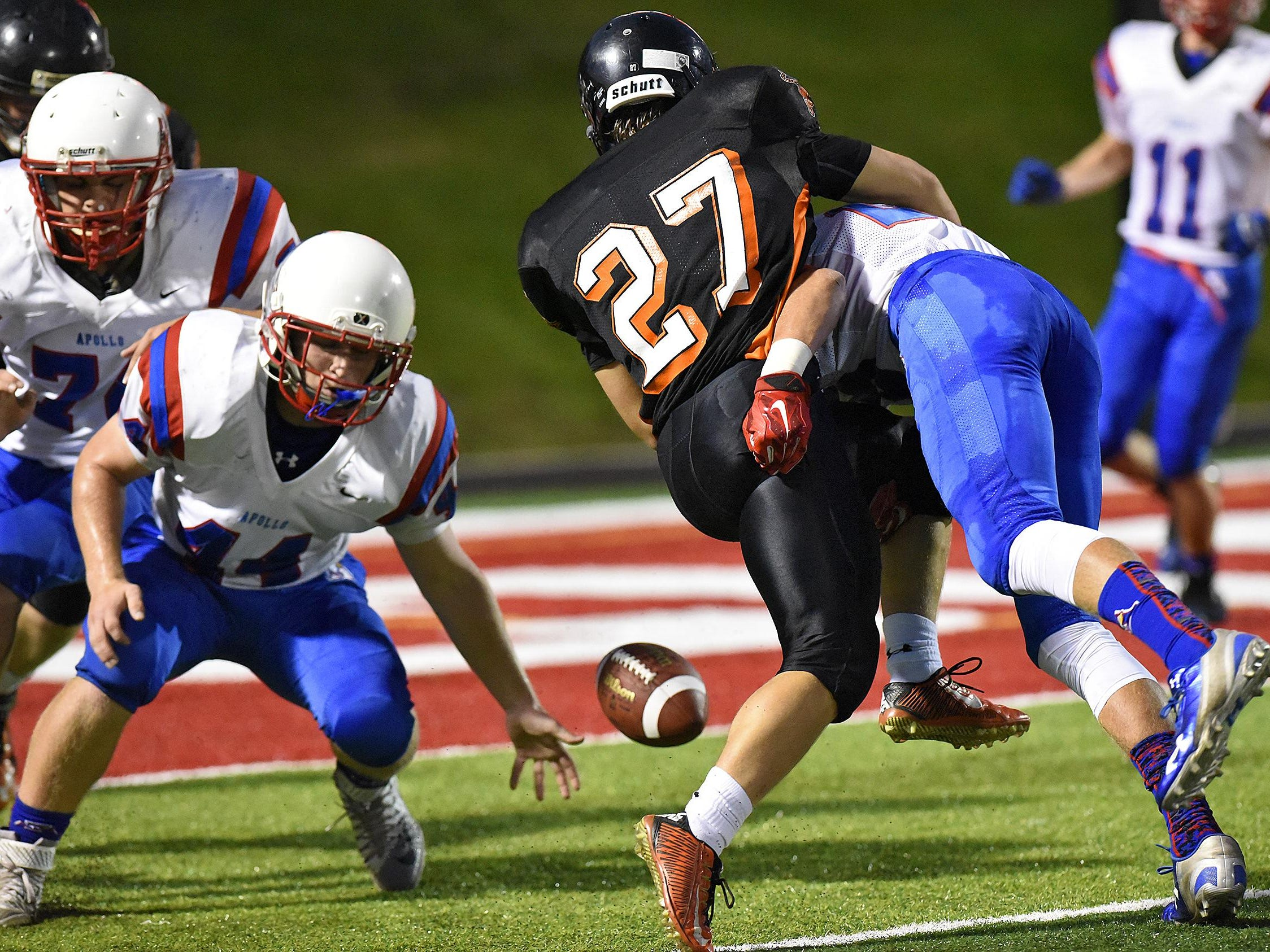 Players concentrate on a loose ball near the goal line during the first half of Friday's game at Husky Stadium in St. Cloud.