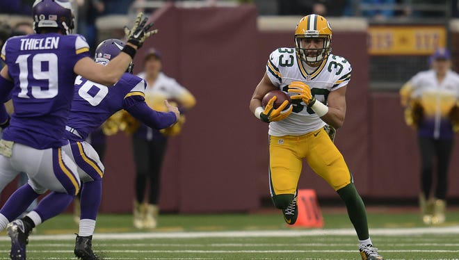 Green Bay Packers' Micah Hyde (33) runs with the ball during a kick-off return against the Minnesota Vikings during Sunday's game at TCF Bank Stadium on the campus of the University of Minnesota in Minneapolis. Evan Siegle/Press-Gazette Media