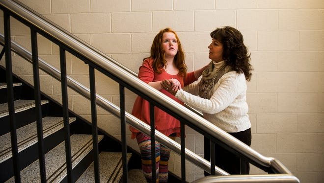 """Kaela Dutterer, 9, is guided by her personal care assistant Juanita Senseney while descending a stairway at Clearview Elementary School Feb. 17, 2016 in Hanover. Dutterer, a nonverbal autistic child, is part of Lincoln Intermediate Unit's special needs classroom that is taught at Clearview Elementary School. """"She's come so far in two years,"""" said Senseney, who's been working with Kaela as a personal care assistant for two years. Kaela also has had a fear of walking on stairs, a behavior her teachers don't understand though according to Senseney it is a fear that's slowly being overcome. """"I work everyday with Kaela on helping with encouragement and giving her confidence,"""" said Senseney."""