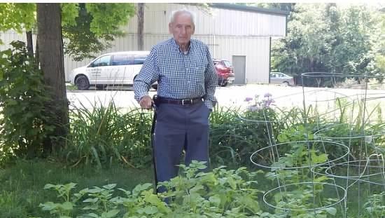 Leon Poelvoorde in his garden in Newfield.