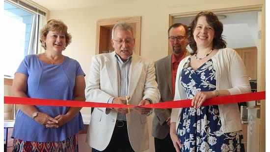 Left to right, Deb Petersen, Frank Carollo, Dale Johnson and Melissa Dunham cut the ribbon to open Mary Ellen's Corner at Hospicare of Ithaca.