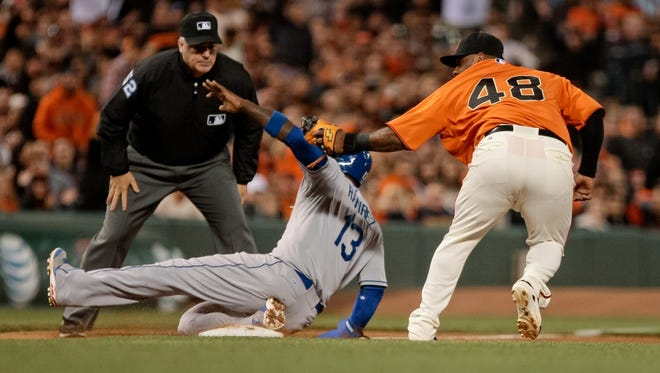 Giants third baseman Pablo Sandoval tags out Dodgers shortstop Hanley Ramirez in May of 2013.