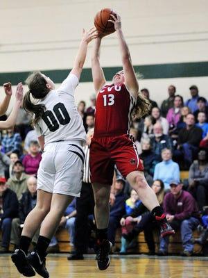 CVU's Marlee Guns fights for a rebound with St. Johnsbury's Saleena Porter during Friday night's high school girls basketball game.