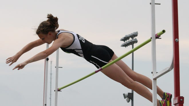 Seton's Anna Schoster clears 9 feet, 6 inches during the Division I district pole vault competition at Winton Woods May 21 last season.