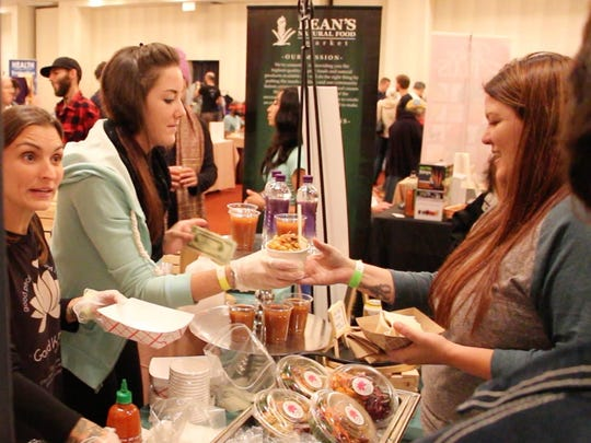 The staff of Good Karma Cafe in Red Bank assists customers with orders at New Jersey VegFest in October in Morristown.