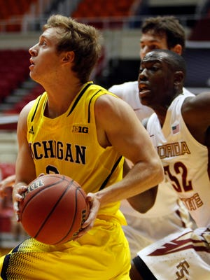 Michigan rallied to beat Florida State 82-80 in overtime.