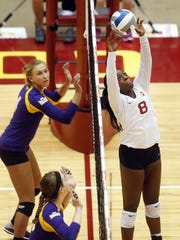 Monique Harris, right, played for Iowa State and Clinton