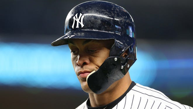 New York Yankees designated hitter Giancarlo Stanton (27) reacts after popping out with two runners on during the third inning against the Miami Marlins at Yankee Stadium.
