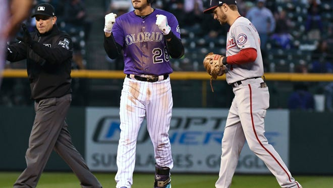 Colorado Rockies' Nolan Arenado (28) gestures at second base after his double during the second inning against the Washington Nationals in a baseball game Friday, Sept. 28, 2018, in Denver. (AP Photo/John Leyba)