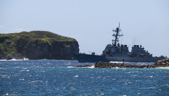 This March 4, 2016, file photo shows the USS Fitzgerald passing through Glass Breakwater in outer Apra Harbor. The harbor is the main reason the United States military began to make Guam a higher priority.