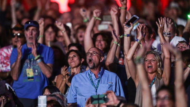 Fans react to The Rolling Stones  perform on the first night of Desert Trip on Friday, October 7, 2016 at the Empire Polo Club in Indio.
