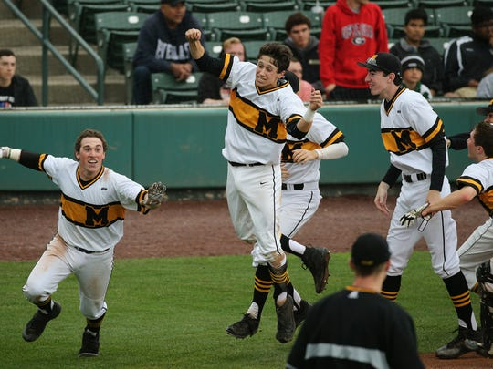 McQuaid's Tyler Griggs (left) and Nick Tomei, who scored the winning run, celebrate a 3-2 come from behind win over Rush Henrietta in 8 innings to capture the Section V Class AA championship.