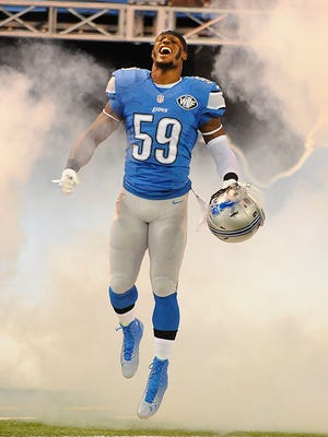 Tahir Whitehead runs onto the field during player introductions before the Lions' game against the Packers in September.