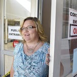 Waite Park City Administrator Shaunna Johnson shows Tuesday the work in progress in the public entrance of city hall.