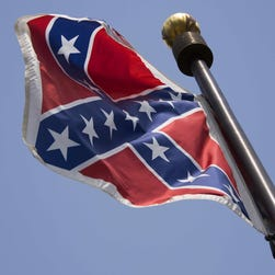 The Confederate flag flies on the South Carolina Statehouse grounds.