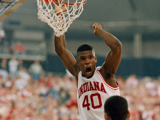 Indiana forward Calbert Cheaney dunks the ball against Wright State defender Mark Woods during their first-round NCAA tournament game in Indianapolis, March 19, 1993.