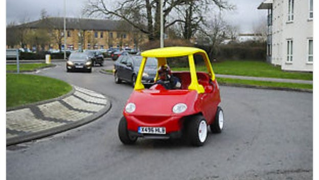 A grown-up version of a children's push car is up for auction on eBay.