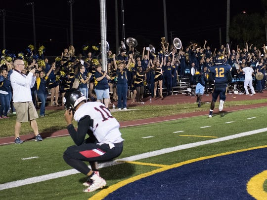 Naples receiver Wooby Theork (12) celebrates with the