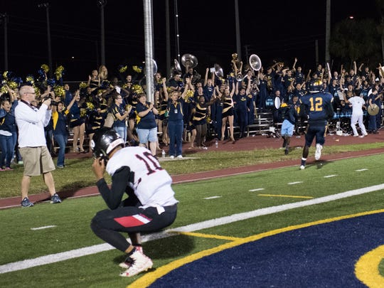 Naples receiver Wooby Theork (12) celebrates with the band after scoring a winning touchdown in the final seconds of the game against Port Charlotte at Naples High Friday night, November 10, 2017.