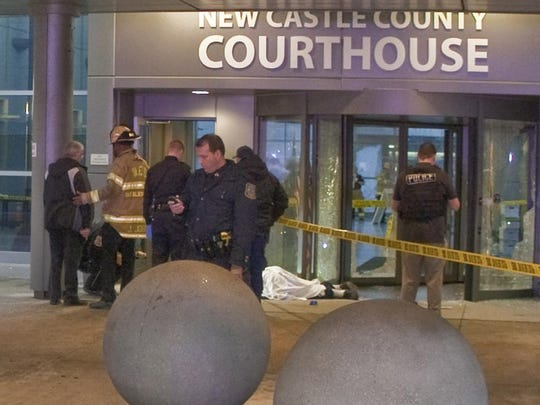 The body of Thomas Matusiewicz lies outside the New Castle County Courthouse after a shooting on Feb. 11, 2013. A jury on Friday issued a guilty verdict following a monthlong trial in the case.