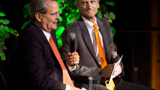 Tennessee basketball color analysts Bert Bertelkamp, left, and Bill Justus tell stories of late broadcaster and colleague John Ward during a tribute to him at Thompson-Boling Arena on Wednesday, June 27, 2018.