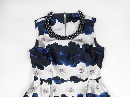 This Gerbera daisy print in navy and white has a rolled jeweled neckline and feels like taffeta. $112 at Bacco Boutique, 1121 Bardstown Road