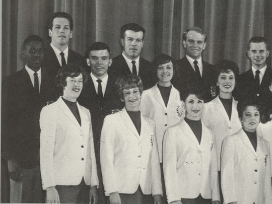 Jan Richard (bottom left) stands among the original cast of the Ball State University Singers. Richard has been with the group for 53 years, now serving as a volunteer mentor.