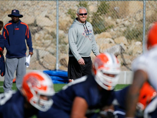 New UTEP head coach Dana Dimel looks on as his team took the field Monday morning for the first day of spring practice under his command. Dimel and his coaching staff look to improve from last years dismal season and bring the Miners back in CUSA play.