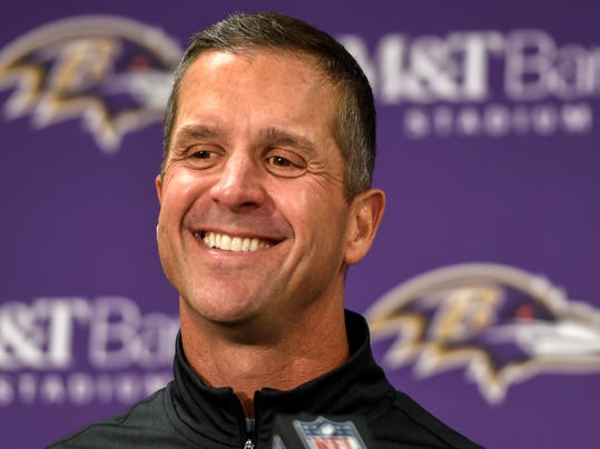 FILE - In this Sunday, Nov. 27, 2016, file photo, Baltimore Ravens head coach John Harbaugh answers a question during a post game press conference after defeating the Cincinnati Bengals 19-14, in Baltimore. With Baltimore leading Cincinnati by seven points, coach Harbaugh told his team to intentionally hold the Bengals to draw penalties while punter Sam Koch ran out of the back of the end zone. The strange but smart strategy ensured a victory for the Ravens rather than risking a fluke fumble or blocked kick. (AP Photo/Gail Burton, File)