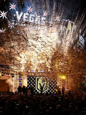 Pyrotechnics and streamers are fired into the air as the Vegas Golden Knights is announced as the name for the Las Vegas NHL franchise at T-Mobile Arena on Nov. 22, 2016.