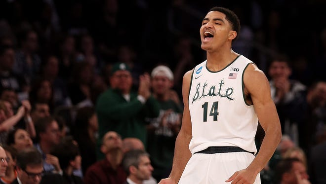 Gary Harris #14 of the Michigan State Spartans reacts after hitting a three pointer late in the first half against the Connecticut Huskies during the East Regional Final of the 2014 NCAA Men's Basketball Tournament at Madison Square Garden on March 30, 2014 in New York City.