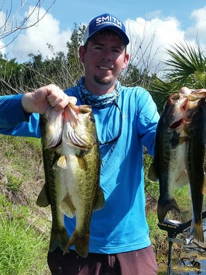 Billy Pfaff Jr. holds up his best four of many Southwest Florida largemouth black bass. Pfaff caught all of his bass on artificial baits while fishing with Capt. JoGene Holaway. All the fish were released alive after the photo.