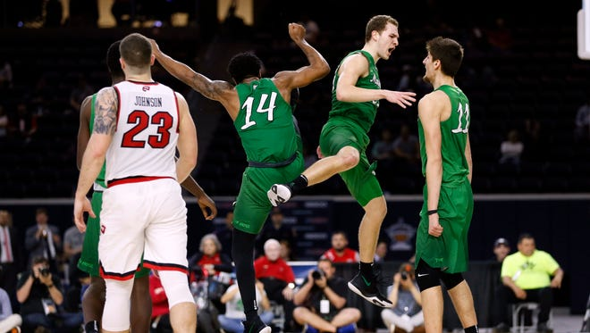 Mar 10, 2018; Frisco, TX, USA; Marshall Thundering Herd guard C.J. Burks (14) and guard Jon Elmore (33) and forward Ajdin Penava (11) react after a time out during the second half against the Western Kentucky Hilltoppers during the Conference USA Tournament at Ford Center at The Star. Mandatory Credit: Tim Heitman-USA TODAY Sports