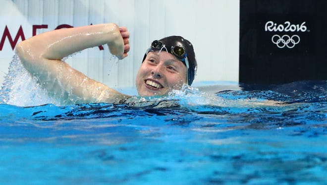 Lilly King celebrates after winning the women's 100-meter breaststroke.