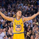 Golden State Warriors guard Stephen Curry (30) celebrates against the Washington Wizards during the second quarter at Oracle Arena.