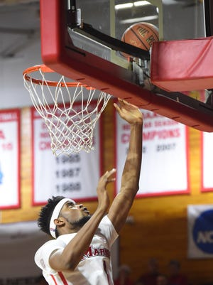 Marist's Kentrall Brooks goes for a layup during Thursday's game against Saint Peter's.