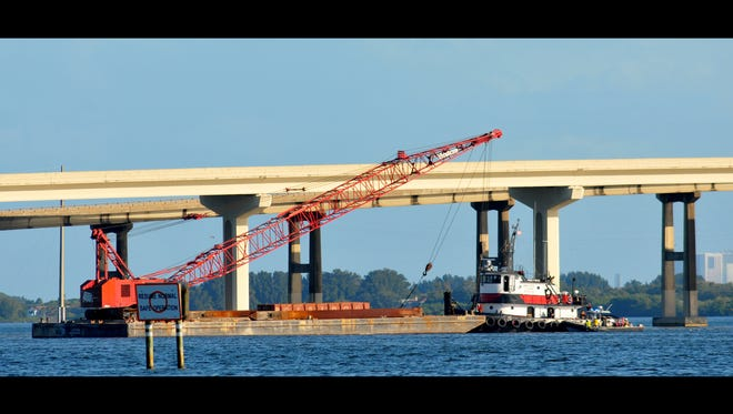 The barge that struck a State Road 528 bridge is seen in this Friday, Oct. 23, 2015 photo.