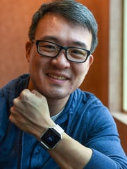 James Park, Fitbit CEO, wears the company's new wearable