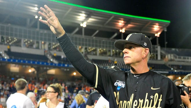 Vanderbilt Head Coach Tim Corbin waves to the fans after winning the College World Series Championship at TD Ameritrade Park in Omaha, Neb., Wednesday, June 25, 2014.