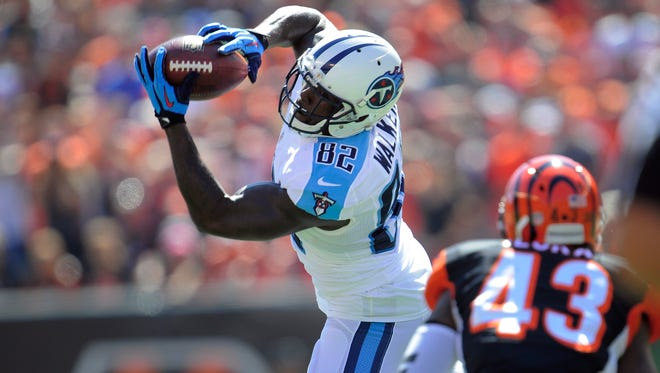 Titans tight end Delanie Walker (82) pulls down a catch over Bengals strong safety George Iloka (43) during the first quarter at Paul Brown Stadium Sunday Sept. 21, 2014, in Cincinnati , Oh.