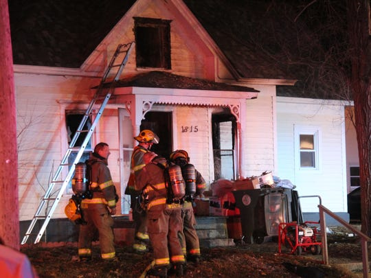 Firefighters pulled three people from a burning home