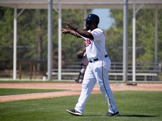 Tommy Watkins coaches third base at a minor league