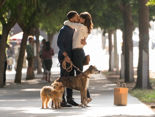 "Nina Dobrev's Elizabeth embraces her co-worker Jimmy, played by Tone Bell, after they confront her ex-boyfriend in ""Dog Days."""