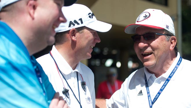 Jim Herman, of Palm City (center), talks with former Cincinnati Reds catcher Johnny Bench after finishing the first round of the Honda Classic 3 under par Thursday, Feb. 23 at PGA National Resort & Spa in Palm Beach Gardens.